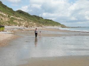 Chasing the boys on the beautiful beach at Whitecliff Bay