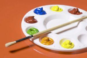 Paintbrush on palette of paint