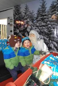 My boys driving Santa's sleigh