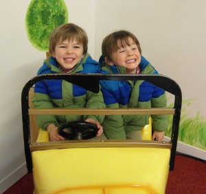 The boys in a ride on car