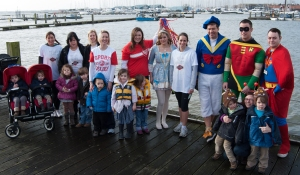 Hading over the baton from TJ Marine to me, Lisa, twin families and B&Q staff in fancy dress